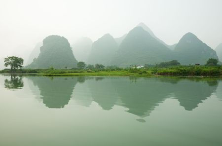 Misty Li river with beautiful reflection, Guilin photo