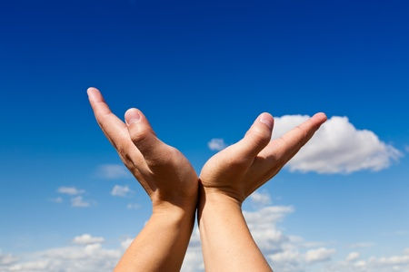 receiving: oupen hand against blue sky