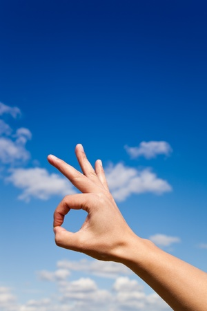 Hand gesture Ok against blue sky Stock Photo - 9510338