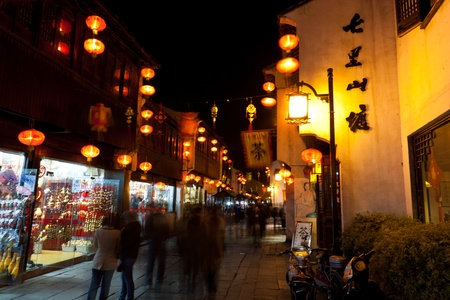 tong: Tourists are walking around Shan Tong Street at night. Shan Tong Street was built in the Tang Dynasty and it has 1,100 years of history. Editorial