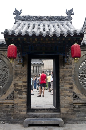 chinese courtyard:  A group of tourists is visiting ancient Chinese building - Wang