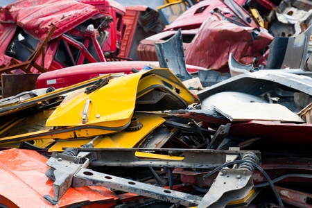 scrap heap: Stacks of crushed cars at junkyard Stock Photo