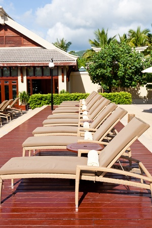 Lounge chairs at resort garden, Sanya, Hainan Island, China
