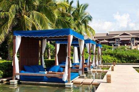 and sanya: Massage beds at the poolside, The Ritz-Carlton Hotel, Sanya, Hainan Island, China Editorial