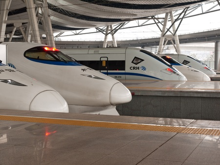 bullet train: five high speed trains stop at station,Beijing South Railway Station, China Editorial
