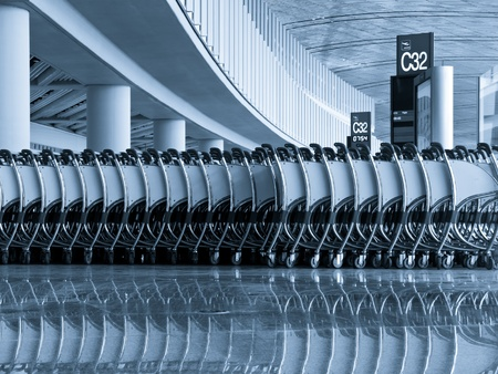 A row of push carts at the departure area, Beijing national airport termital 3.