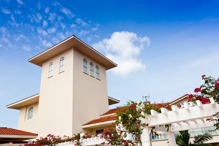 Exotic apartment. Bougainvillea climbing around the building.Golden Palm Resort of Sanya, Hainan Island, China