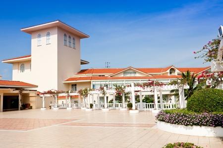 Exotic hotel terrace. Bougainvillea climbing around the pergola.  Golden Palm Resort of Sanya, Hainan Island, China
