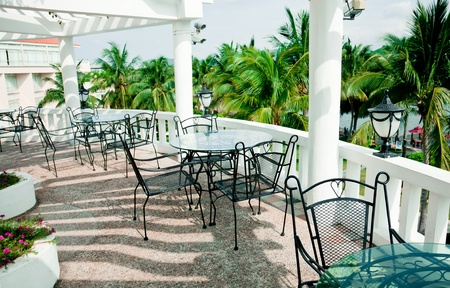 Cafe terrace with Iron patio furniture.Palma Dorada Inn Hotel Sanya, Hainan Island, China