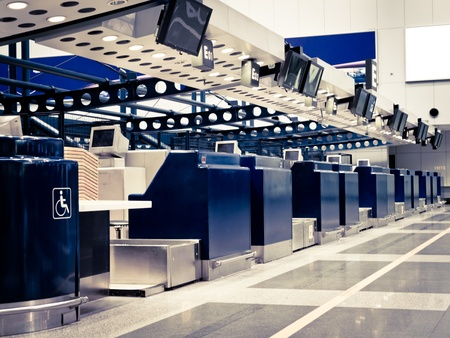 departure board: Airport Check-in Counters, Beijing International Airport, China Editorial