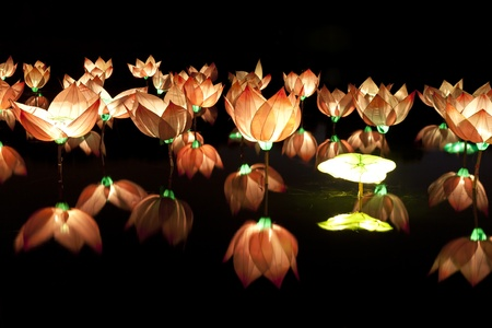 lotus lantern: lotus lamp floating on water Stock Photo