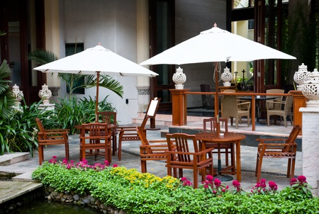 Outdoor cafe at hotel garden, Eadry Resort Sanya, Hainan Island, China Editorial