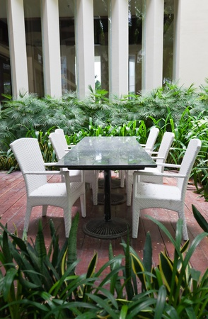 courtyard: Dinning table and chairs in garden, Eadry Resort Sanya, Hainan Island, China  Editorial