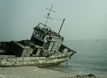 Rusty ship at the beach
