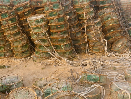 lobster pots: Lobster pots and wooden boat at the beach Stock Photo