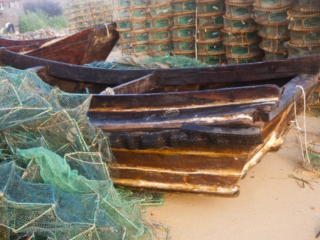 lobster boat: Lobster pots and wooden boat at the beach Stock Photo