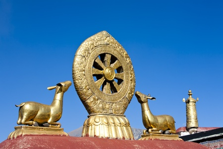 Golden deer and dharma wheel at the Jokhang Temple in Lhasa, Tibet photo