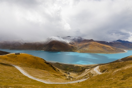 himalayas: Yamdrok Yumsto Lake surrounding by snow mountains which is the most sacred lake in Tibet.