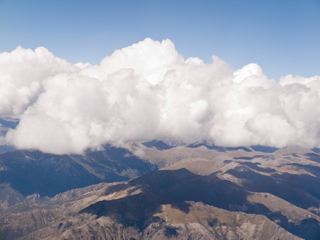 Beautiful landscape of cloud and mountain, shot from airplane. photo