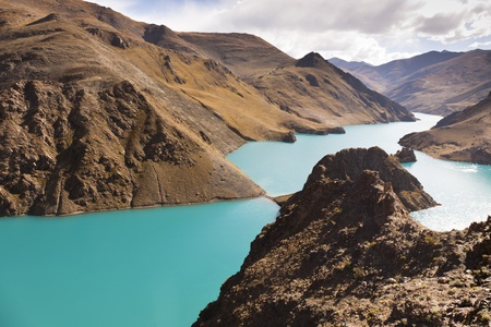 Yamdrok Yumsto Lake surrounding by snow mountains which is the most sacred lake in Tibet.