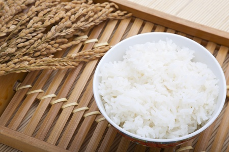 Bowl of rice and paddy on a place mat photo