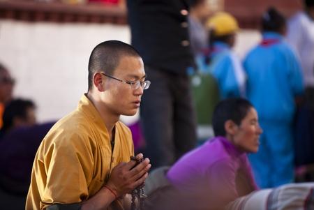 recite: A monk is praying at Jokhang Temple. Lhasa, Tibet, China.