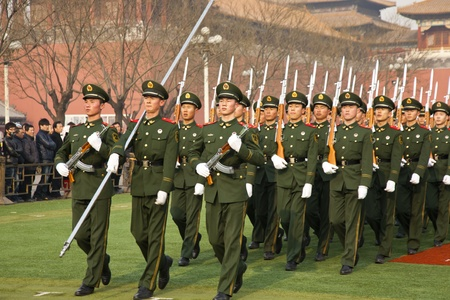 Beijing, China - December 27, 2011. Young soldiers marching in the Forbidden City.