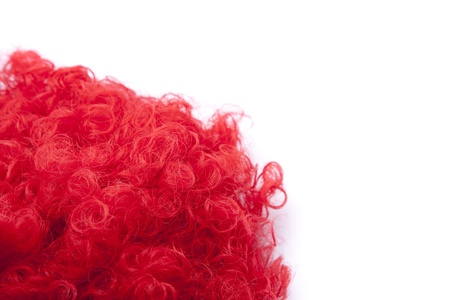 Red curly wig over white background Stock Photo - 12868737