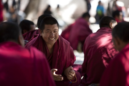 Lhasa, China - October,7, 2011: Tibetan Buddist monks is debating at Sera Monastery, Lhasa, Tibet.
