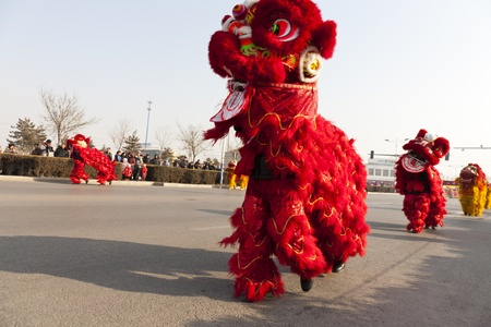 Yu County, Hebei province, China - February 5th, 2012: Chinese people celebrated Lantern Festival by showing traditional lion dancing.