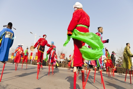 hebei province: Yu County, Hebei province, China - February 5th, 2012: Chinese people celebrated the Spring Festival. The celebration activities are extremely rich and varied. People in my photo are showing stilt-walking that is folk performance.
