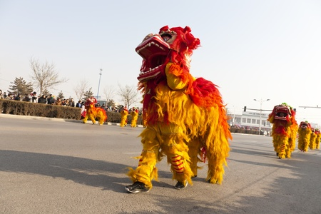 hebei province: Yu County, Hebei province, China - February 5th, 2012: Chinese people celebrated Lantern Festival by showing traditional lion dancing.