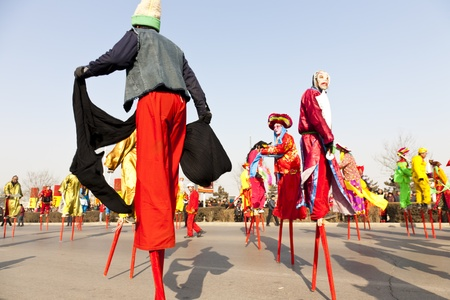 Yu County, Hebei province, China - February 5th, 2012: Chinese people celebrated the Spring Festival. The celebration activities are extremely rich and varied. People in my photo are showing stilt-walking that is folk performance. Stock Photo - 13266313