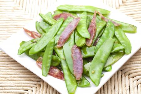 green pea: Sauted sausage and snow peas Stock Photo