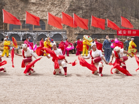 chinese drum: Yanan, China - April 20, 2012: People are performing Ansai Waist Drum Dance. The Ansai Waist Drum dance is a folk dance with a history of more than 2,000 years in Northern Shanxi Province of midwest China.