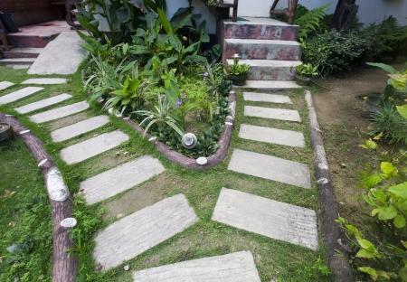 Stone paved footpath through garden  photo