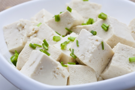 Tofu and sliced scallion in white bowl  photo