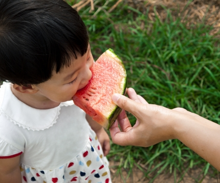 girl is eating watermelon photo