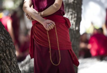 Prayer bead in lama s hand , Tibet