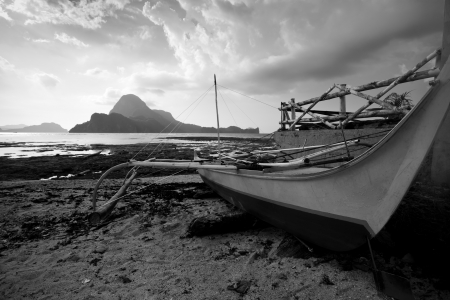 An abandoned ship on the beach, black and white toned photo