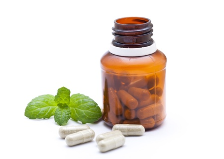 naturopath: Organic capsule with mint leaves  Stock Photo