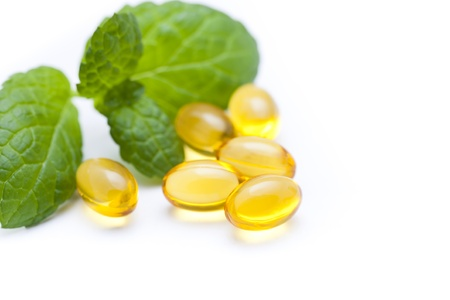 Gel vitamin capsules with mint leaf photo