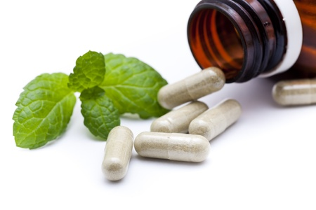 Organic capsule with mint leaves Standard-Bild
