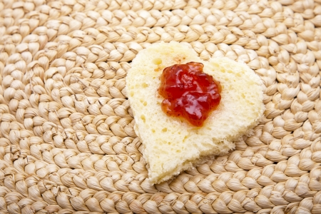 Jam on heart shaped toast  photo