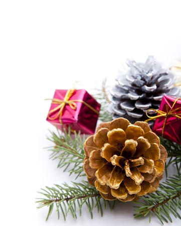 Christmas ornaments  golden and silver pine cones and gift box on white background Stock Photo - 16566080