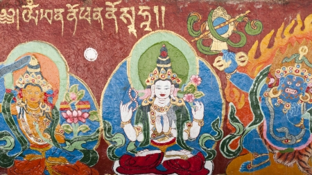 samsara: Religious Tibetan Thangka of White Tara painted on the temple wall, Lhasa, Tibet