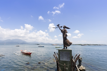 palawan: Puerto Princesa, Philippines - 07 April, 2012: A statue of girl with pigeon at wharf. Puerto Princesa is the provincial capital city in Palawan.