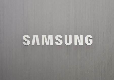Close up of the Samsung logo on a laptop surface. Samsung Electronics Co., Ltd. headquarters in South Korea.  Editorial