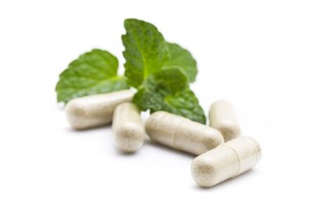 Organic capsule on mint leaves