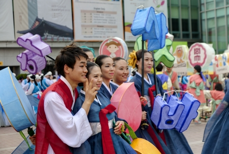 south asian ethnicity: Seoul, South Korea - May 12, 2013: Young people wearing traditional clothes are taking pictures before participating Culture Performances for celebration of Lotus Lantern Festival at Jogyesa Temple, Seoul, South Korea. Buddha?s birthday is a major event o Editorial